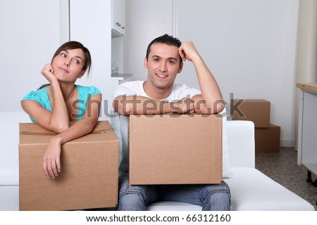 Young couple moving in new place - stock photo