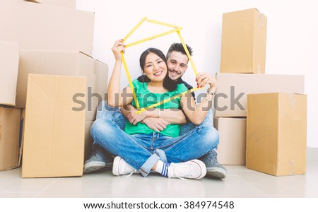 Young couple moving into new house - stock photo