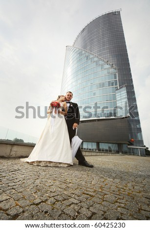 young couple near modern building - stock photo