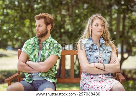 Young couple not talking after argument on a summers day - stock photo