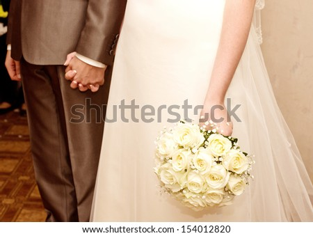 Young couple of lovers who are just married with bouquet - stock photo