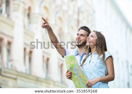 Young couple of tourists on street
