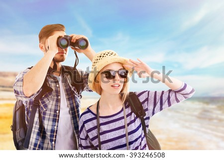 Young couple of travelers on nature background