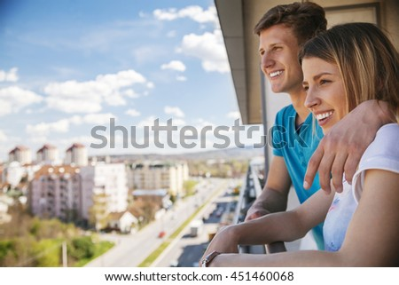 Young Couple On A Balcony - stock photo