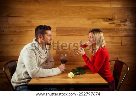 Young couple on a date in a restaurant on a Valentine's Day - stock photo