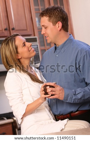 Young couple on a kitchen