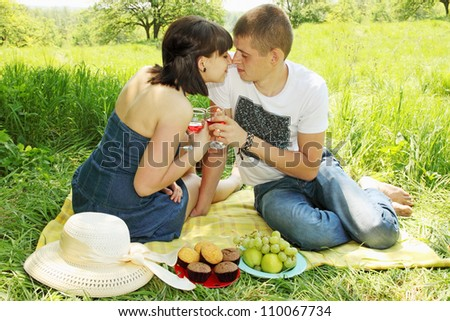 Young couple on a picnic with wine