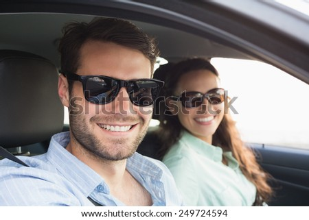 Young couple on a road trip in their car - stock photo
