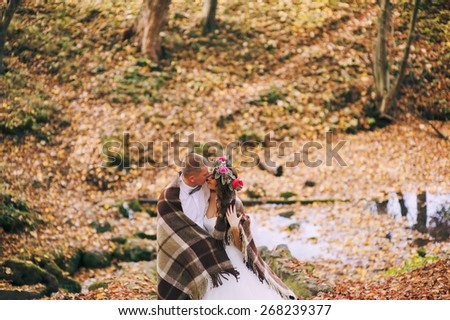 young couple on a walk in the autumn forest