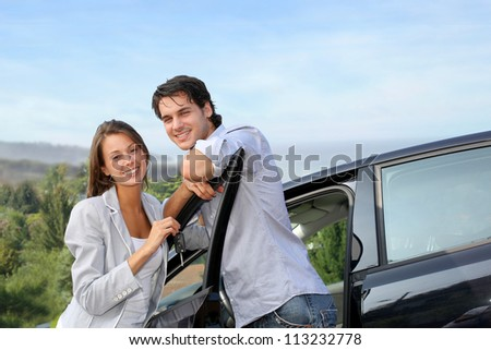 Young couple on a week-end trip in car - stock photo