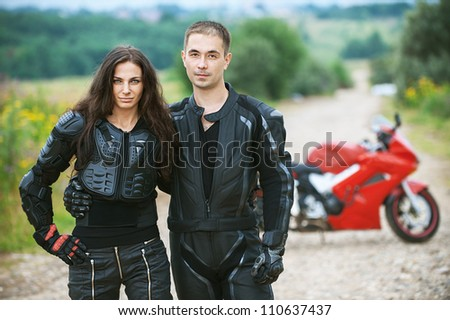 Young couple on background of beautiful bike.