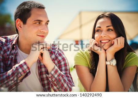 young couple on first date, outdoor shot summer day - stock photo