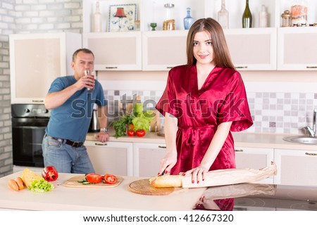 young couple on kitchen having breakfast - stock photo