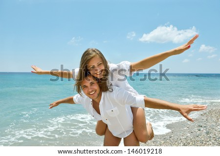 young couple on the beach. - stock photo
