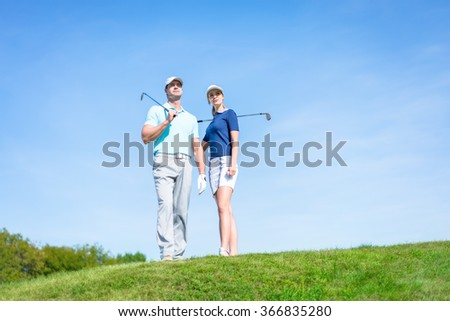 Young couple on the golf course