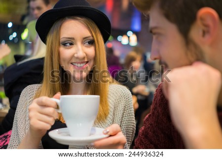 Young couple on the night city restaurant - stock photo