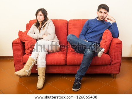 Young Couple on the Sofa after Quarrel