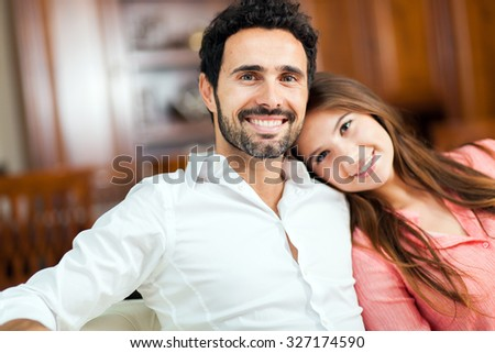 Young couple on the sofa in love  - stock photo