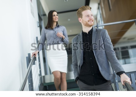 Young couple on the stairs in office
