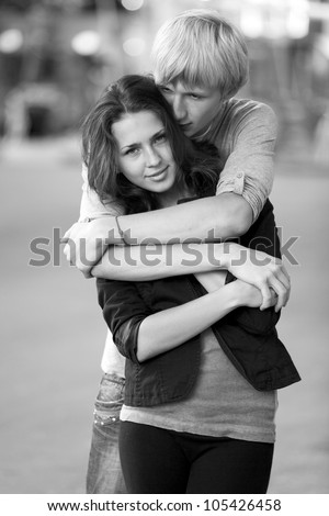 Young couple on the street of the city. Photo in black and white style. - stock photo