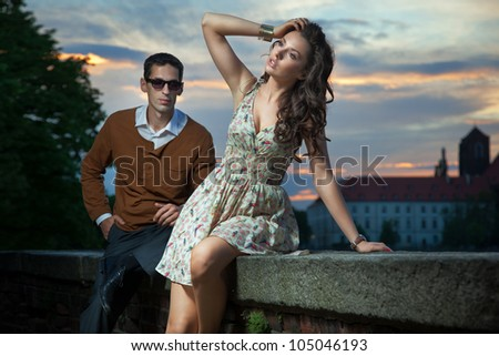 Young couple on the sunset background
