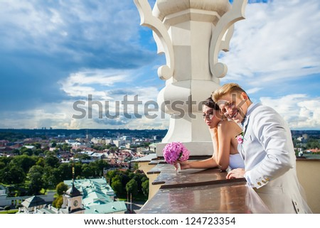 Young couple on their wedding day enjoying panoramic view