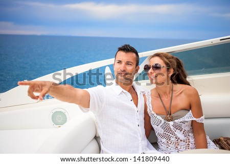 Young couple on their yacht at sea - stock photo