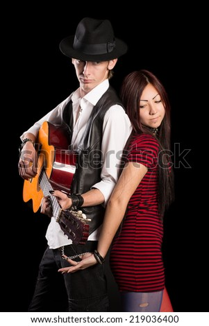 Young couple performing a musical song. Asian woman and Caucasian man. - stock photo