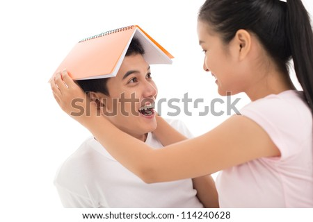 Young couple planning their future together, an important thing being roof over head - stock photo