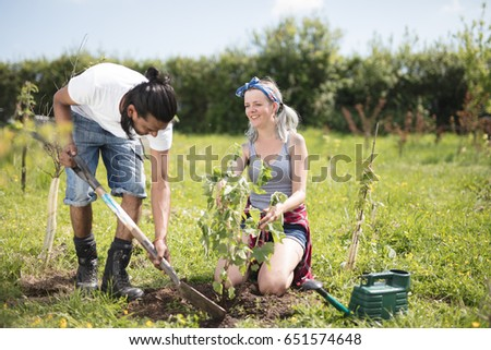 Young couple planting a tree