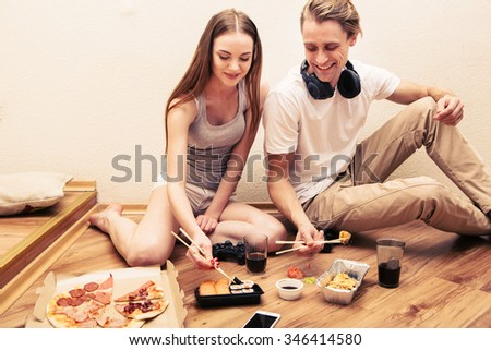 Young couple playing computer game home together, hobby, addiction eat - stock photo