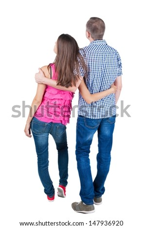 young couple pointing at wal Back view  (woman and man). looking into the distance. Rear view people collection.  backside view of person.  Isolated over white background.