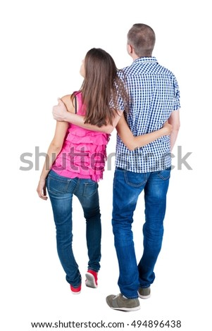 young couple pointing at wal Back view woman and man . looking into the distance. Rear view people collection. backside view of person. Isolated over white background.