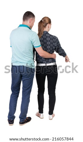 young couple pointing. Back view.  Rear view people collection.  backside view of person.  Isolated over white background.