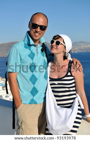 young couple portrait in love have romantic time on summer vacation holidays in greece santorini - stock photo