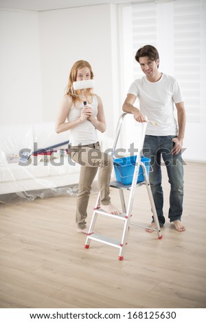 young couple preparing to paint their new home