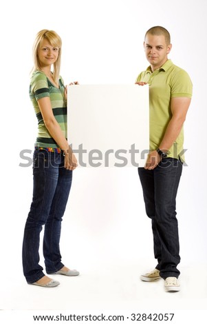 young couple presenting a blank board