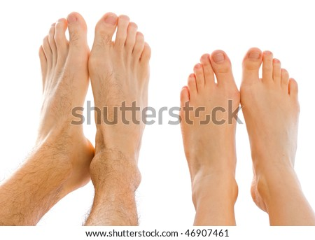Young couple putting together the feet in the studio - stock photo