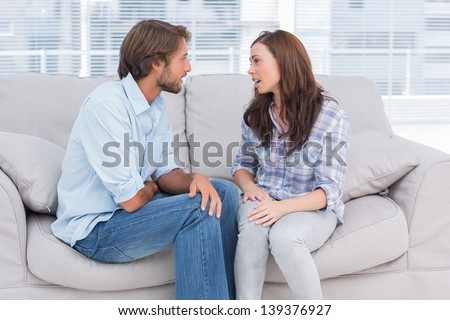 Young couple quarreling in the office of therapist