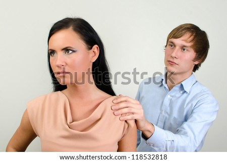 Young couple quarreling. Man asks for forgiveness.