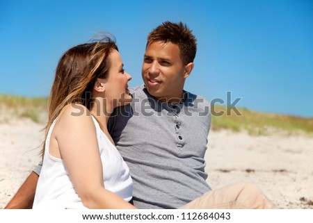 Young couple relaxing and looking happy in their summer vacation