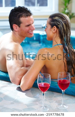Young couple relaxing in hot tub. Summer vacation. - stock photo