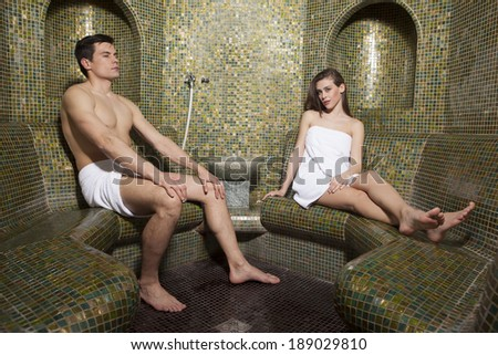 Young couple relaxing in spa  - stock photo