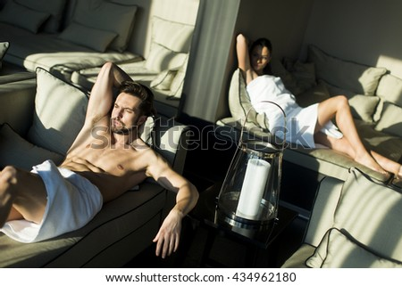 Young couple relaxing in the room - stock photo