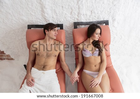 Young couple relaxing in the salt room - stock photo