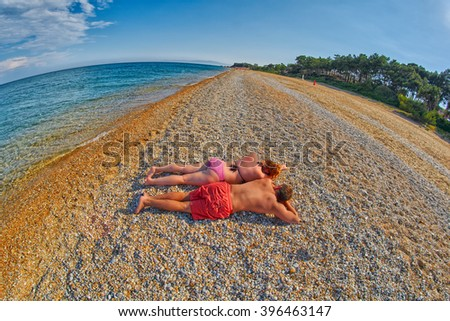 Young Couple Relaxing on a Skala Beach in Kefalonia, Greece