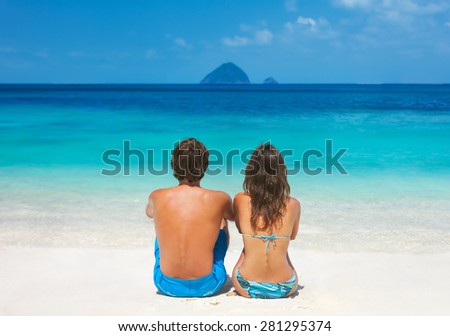 Young couple relaxing on the paradise beach - stock photo
