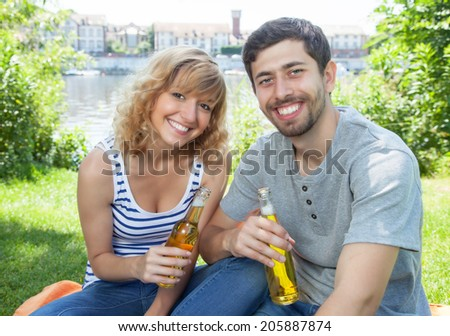 Young couple relaxing outdoor - stock photo