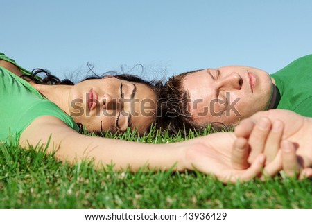 young couple relaxing outdoors - stock photo