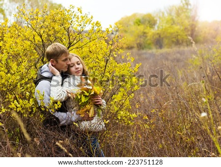 Young couple relaxing outdoors in autumn - stock photo